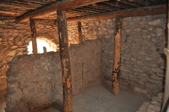 In reality, there were no doorways; access was by ladders through a hole cut in the roof